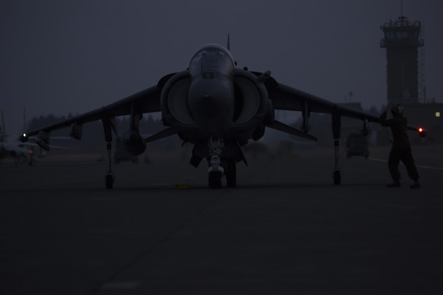 A U.S. Marine Corps AV-8B Harrier takes its spot on the flight line after arrival to Chitose, Japan, Dec. 5, 2016. Following the arrival of the squadron's Harriers, a press conference was held to acknowledge questions pertaining to the aircraft and the Aviation Training Relocation Program. (U.S. Marine Corps photo by Lance Cpl. Joseph Abrego)
