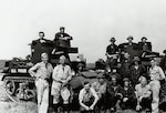 Members of Company D, 192nd Tank Battalion, Kentucky National Guard, pose with their vehicles at Ft. Knox, Ky., during the unit's training prior to World War II.  Called into federal service pursuant to the national emergency declared by President Franklin D. Roosevelt in 1940, the 192nd, along with the Guard's 194th Tank Battalion, were deployed to reinforce the Army garrison of the Philippines.