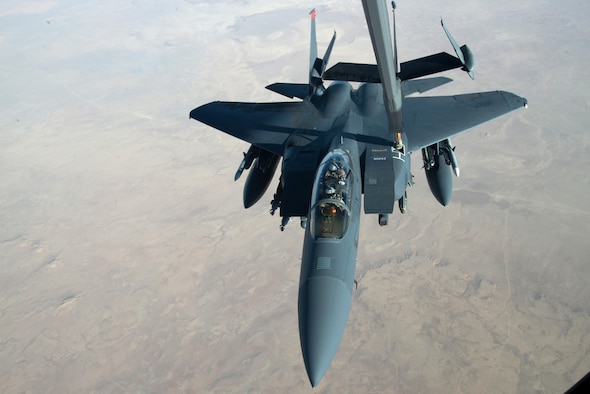 A U.S. Air Force F-15E Strike Eagle receives fuel from a KC-10 Extender centerline refueling boom near Mosul, Iraq, Nov 20, 2016. The F-15E Strike Eagle is a dual-role fighter designed to perform air-to-air and air-to-ground missions. An array of avionics and electronics systems gives the F-15E the capability to fight at low altitude, day or night, and in all weather. (U.S. Air Force photo by Staff Sgt. R. Alex Durbin)