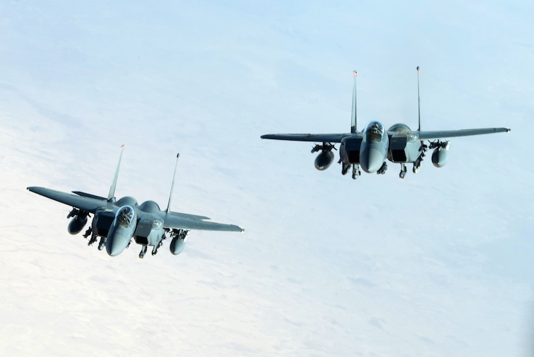 Two U.S. Air Force F-15E Strike Eagles fly in formation near Mosul, Iraq, Nov. 20, 2016. To date, Coalition forces have flown thousands of combat sorties using a wide range of strike aircraft to dismantle, disrupt and ultimately destroy Da'esh by striking infrastructure, roadways and other high-value targets. (U.S. Air Force photo by Staff Sgt. R. Alex Durbin)