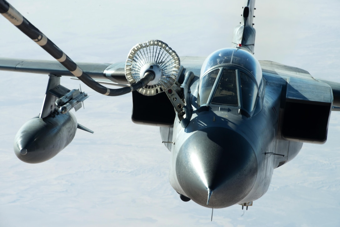 A German air force GR-4 Tornado refuels using a drogue-and-hose system from a U.S. Air Force KC-10 Extender near Mosul, Iraq, Nov. 20, 2016. Air Force refueling teams train to refuel aircraft from all nations both home and around the globe to embody the joint approach to warfare. (U.S. Air Force photo by Staff Sgt. R. Alex Durbin)