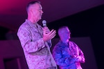 Marine Corps Gen. Joe Dunford, chairman of the Joint Chiefs of Staff, and his senior enlisted advisor, Army Command Sgt. Maj. John W. Troxell, speak to the troops before the USO show at al Udeid Air Base, Qatar, Dec. 6, 2016. DoD photo by Navy Petty Officer 2nd Class Dominique A. Pineiro