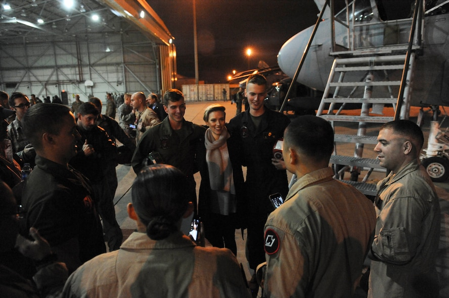 Actress Scarlett Johansson stands with U.S. service members for a photo Dec. 5, 2016, at Incirlik Air Base, Turkey. This trip was Johansson's first time on a USO Holiday Visit, a tradition that goes back to former chairman of the Joint Chiefs of Staff, U.S. Air Force Gen. Richard B. Myers in 2003. (U.S. Air Force photo by Airman 1st Class Devin M. Rumbaugh)