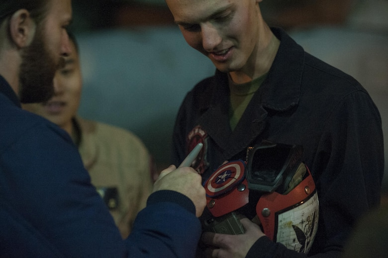 Actor Chris Evans signs a service member's protective gear Dec. 5, 2016, at Incirlik Air Base, Turkey. Evans was one of many USO entertainers to visit Incirlik as a part of the 2016 USO Holiday Visit. The visit also included actress Scarlet Johansson, 4-time Olympic medalist Maya DiRado, entertainer Jim Karol, country music star Craig Campbell and NBA legend Ray Allen. (U.S. Air Force photo by Tech. Sgt. Joshua T. Jasper)