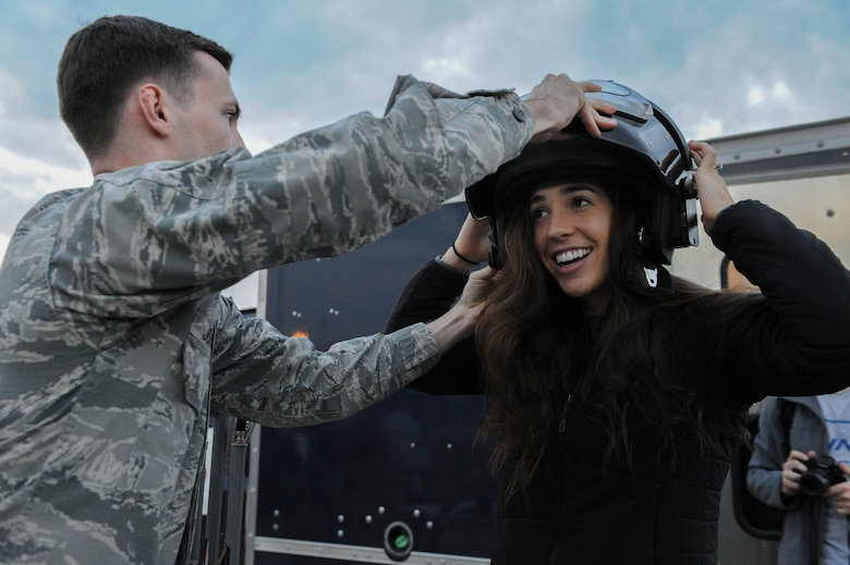 U.S. Air Force Senior Airman Alex Johnson, a 39th Civil Engineer Squadron explosive ordnance disposal journeyman, helps Four-time Olympic medalist Maya DiRado put on a bomb suit helmet Dec. 5, 2016, at Incirlik Air Base, Turkey. DiRado was one of the USO entertainers that accompanied U.S. Marine Corps Gen. Joseph F. Dunford, Jr., chairman of the Joint Chiefs of Staff, on the 2016 USO Holiday Visit. (U.S. Air Force photo by Airman 1st Class Devin M. Rumbaugh)
