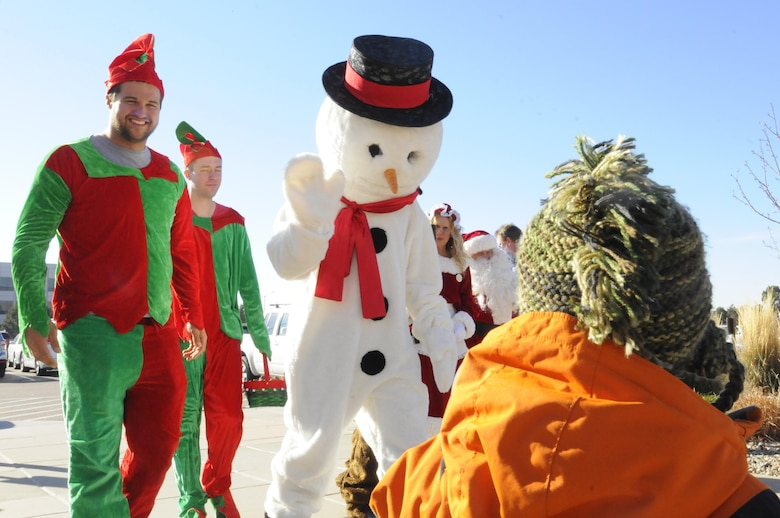 Frosty and elves greet families and children during the 2016 Candy Land Children's Holiday Fest at Schriever Air Force Base, Colorado, Saturday, Dec. 3, 2016. Frosty and Rudolph were some of the special guests during the family festival. (U.S. Air Force photo/1st Lt. Darren Domingo)