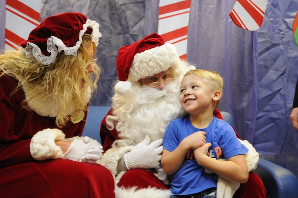 Jackson Rosenfeldt shares his Christmas wishes with Santa and Mrs. Claus during the 2016 Candy Land Children's Holiday Fest at Schriever Air Force Base, Colorado, Saturday, Dec. 3, 2016. The free Santa experience saved families trips into town to meet Santa. (U.S. Air Force photo/1st Lt. Darren Domingo)