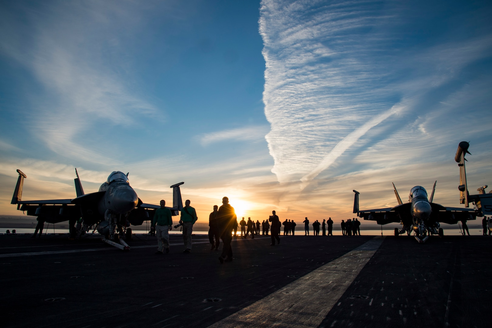 161204-N-QI061-027 SUEZ CANAL (Dec. 4, 2016) Sailors walk across the flight deck of the aircraft carrier USS Dwight D. Eisenhower (CVN 69) conducts a routine, scheduled transit through the Suez Canal. The ship and its carrier strike group are deployed in support of Operation Inherent Resolve, maritime security operations and theater security cooperation efforts in the U.S. 5th Fleet area of operations. (U.S. Navy photo by Petty Officer 3rd Class Nathan T. Beard/Released)