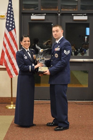 Lt. Col. Yira Muse, 313th Recruiting Squadron commander, presents the Gold Badge award to Staff Sgt. Sean Stanton, 313th RCS F-flight during the 313th RCS Annual Training at Niagara Falls Air Reserve Base, New York, Nov 7.