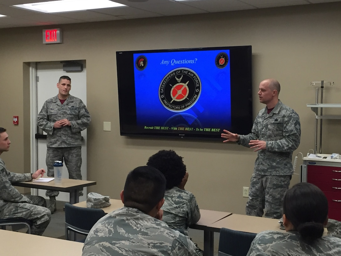 319th Recruiting Squadron, Master Sgt. Cory Kelly, and Chief Master Sgt. Michael Kovach, brief 58 members of the 66th Medical Squadron on the Developmental Special Duties process and recruiting at Hanscom Air Force Base, Massachusetts, Dec. 1.