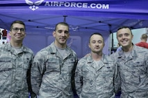 Members of the 332nd Recruiting Squadron attend the Battle of Barbell CrossFit event to promote Battle Field Airmen in Murfreesboro, Tennessee, Nov. 19. From left are: Staff Sgt. James McCullough, Tech. Sgt. Justin McEldowney, Tech. Sgt. Donnie Perry and Tech. Sgt. Miles Gravage.