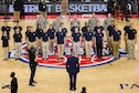 Capt. Adrian Law, 339th Recruiting Squadron support commander, swears in Delayed Entry Program members during the pregame ceremony at the National Basketball Association Detroit Pistons and Miami Heat game in Auburn Hills, Michigan, Nov. 23.