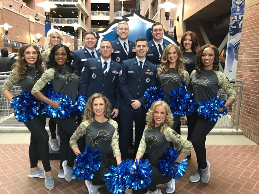 Members of the 339th Recruiting Squadron pose with Detroit Lions cheerleaders during the National Football League Detroit Lions and Jacksonville Jaguars game in Detroit, Nov. 20. From left are: Tech Sgt. Joseph Glorso, Tech. Sgt. Lewis Wilder, Staff Sgt. Joseph Burns, Staff Sgt. Michael Medendorp, and Tech. Sgt. Michael Scanlon.