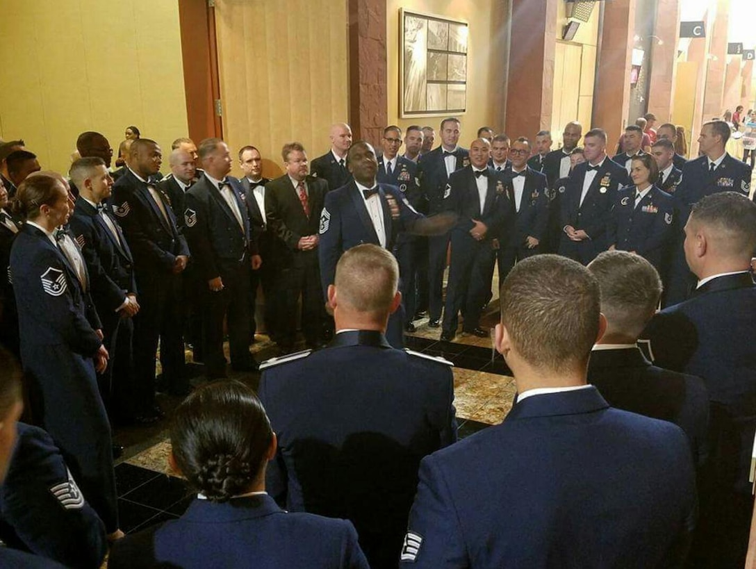 """Retired Command Chief Master Sgt. Juan Lewis speaks to members of the 369th Recruiting Squadron during the FY16 Annual Awards Banquet in Layton, Utah, Nov. 15. Lewis spoke about pride, enthusiasm, and passion in all ways of life, especially in support of young Airmen """"as they spread their wings""""."""