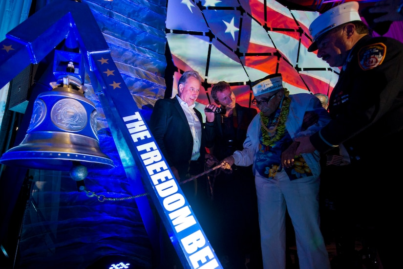 "Ray Chavez, the oldest living World War II veteran at age 104, rings the ""Freedom Bell"" at the ""December 7th Remembered"" gala honoring Pearl Harbor survivors and World War II veterans in Honolulu, Dec. 6, 2016. The bell, which is displayed in various cities, was cast in bronze with steel from the Twin Towers. DoD photo by Lisa Ferdinando"