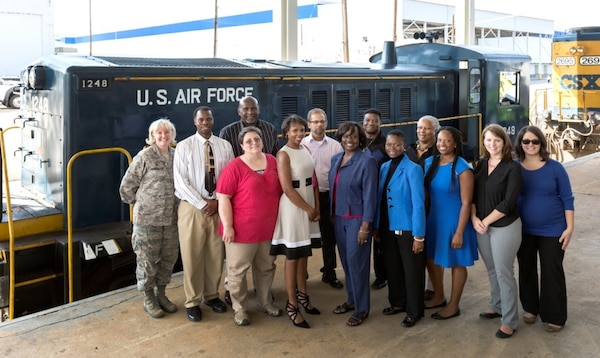 On Oct. 20, a group of Defense Contract Management Agency Lockheed Martin Marietta and Lockheed Martin Marietta employees gathered to retire the Air Force's 60-ton railroad switch engine 1248. DCMA participants at the event included Air Force Col. Sheri Bennington (left), Martin Marietta, Blair Evans, Tammy Ellis, Marguerite Antoine, Glenda Robertson-Allen, Denise Jones, Shalonda Wilson, Amanda Akin and Sarah Sullivan. Bernard Latimore (back row, left), Leonard Rishell, Donald Runner and LaNorma Shelton-Thomas, gather for a photo in front of switch engine 1248. (Lockheed Martin photo by Todd McQueen)