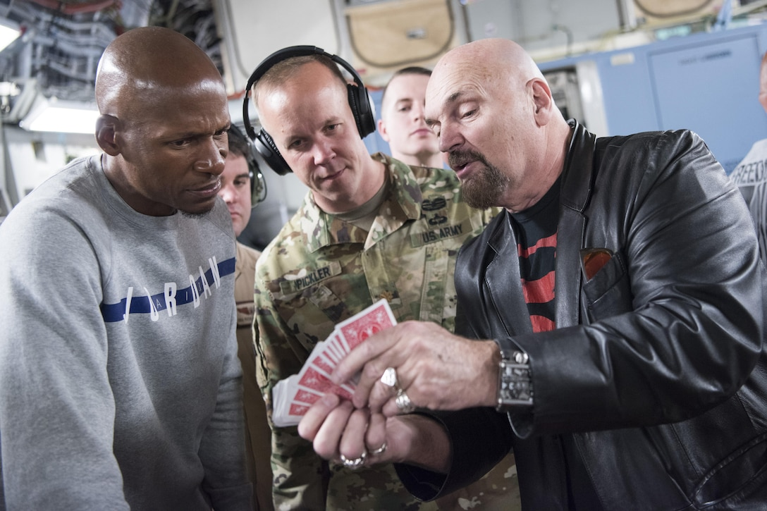NBA Legend Ray Allen and mentalist Jim Karol go over illusions on a C-17 Globemaster III while traveling to Al-Udeid Air Base, Qatar.