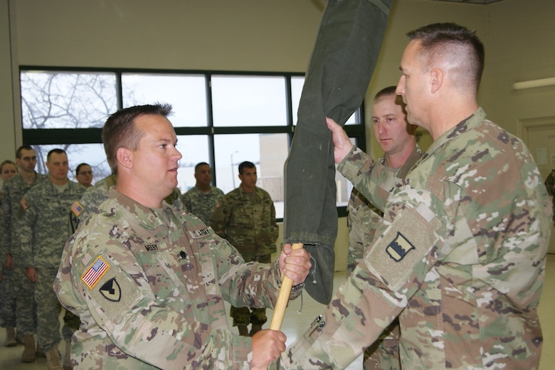 (Left) Lt. Col. Ryan Melby, commander of the 3rd Battalion, 399th Regiment, receives the encased battalion colors from Col. Bradly Boganowski, commander of the 800th Logistics Support Brigade, at the battalion's deactivation ceremony as 1st Sgt. Michael Olson, the battalion's first sergeant, looks on. The deactivation was held at the Army Reserve Center in Sturtevant, Wis., Dec. 3, 2016.