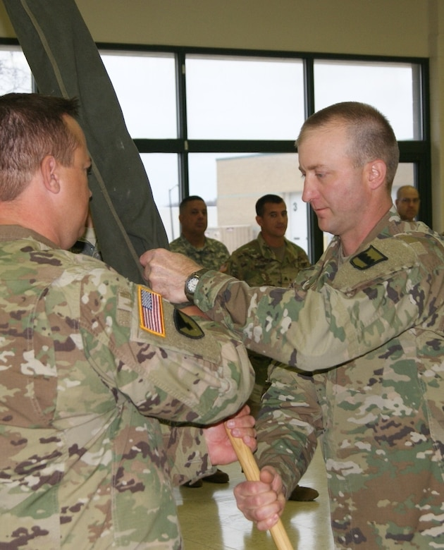 (Left) Lt. Col. Ryan Melby, commander of the 3rd Battalion, 399th Regiment, passes the encased battalion colors to 1st Sgt. Michael Olson, the battalion's acting command sergeant major, at the unit's deactivation ceremony held at the Army Reserve Center in Sturtevant, Wis., Dec. 3, 2016.