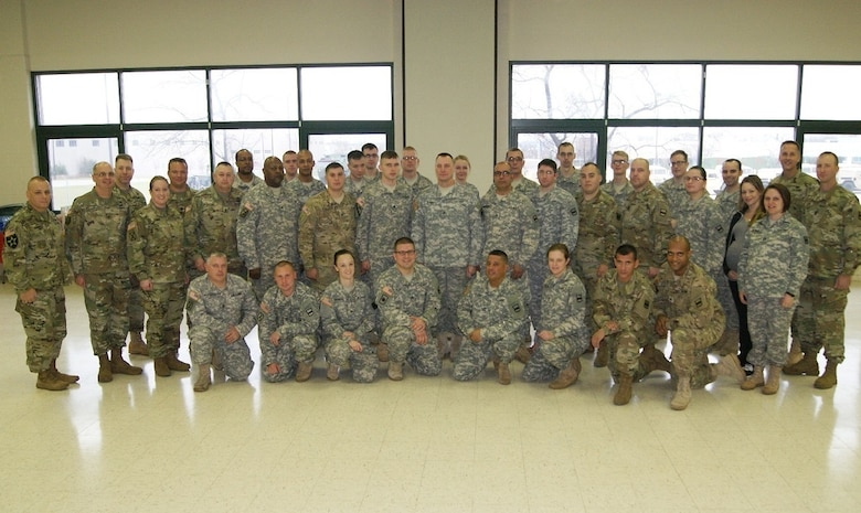 Soldiers of the 3rd Battalion, 399th Regiment pose together at their last battle assembly at the Army Reserve Center in Sturtevant, Wis., where they held their deactivation ceremony on Dec. 3, 2016.