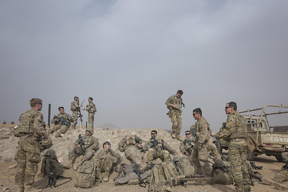 Members of Able Platoon, 1st Squadron, 3rd Cavalry Regiment, and Tech. Sgt. Jeremy Rarang, 817th Expeditionary Air Support Operations Squadron joint terminal attack controller, joke together after training Nov. 21, 2016 at Forward Operating Base Dahlke, Afghanistan. JTACs direct aircraft for use during close air support and offensive operations from a forward position. (U.S. Air Force photo by Staff Sgt. Katherine Spessa)