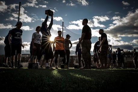 A student of Danvers High School in Danvers, Mass., completes the final ammunition can lift for his team during a Marine Corps Leadership Seminar class and workout at the high school football field, Dec. 2, 2016. The Marines of Recruiting Substation North Boston conducted a leadership seminar with the hockey team of Danvers High School, which consisted of a class on Marine Corps leadership traits followed by a circuit course workout. Marine recruiters conduct these seminars at the request of a school or sports team to teach the group how the Marines shape leaders and build team cohesion.