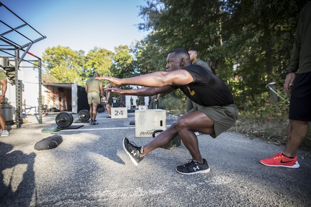 A Force Fitness Instructor Trainer demonstrates the proper execution of a pistol squat. While attending the course, students will learn how to perform and coach a variety of exercises and movements.