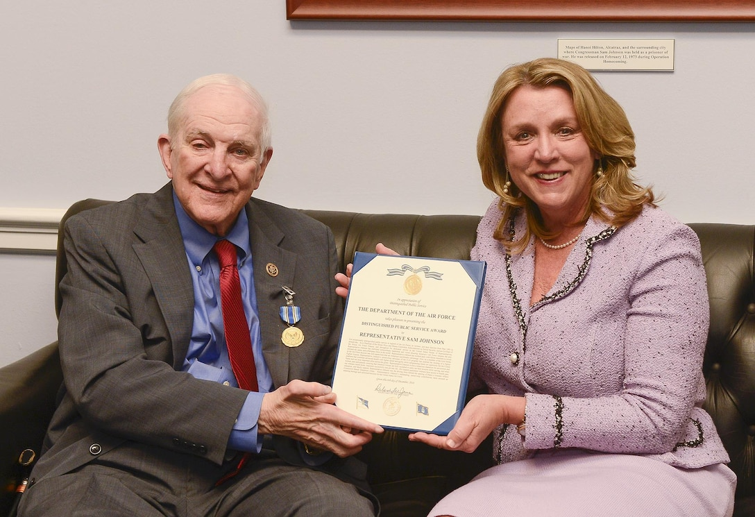 Air Force Secretary Deborah Lee James presents the Distinguished Public Service Award to U.S. Rep. Sam Johnson (R-TX), in Washington, D.C. Dec 6, 2016. Johnson was the driving force behind opening Plano's Veterans Affairs Community-Based Outpatient Clinic. (U.S. Air Force photo/Andy Morataya)