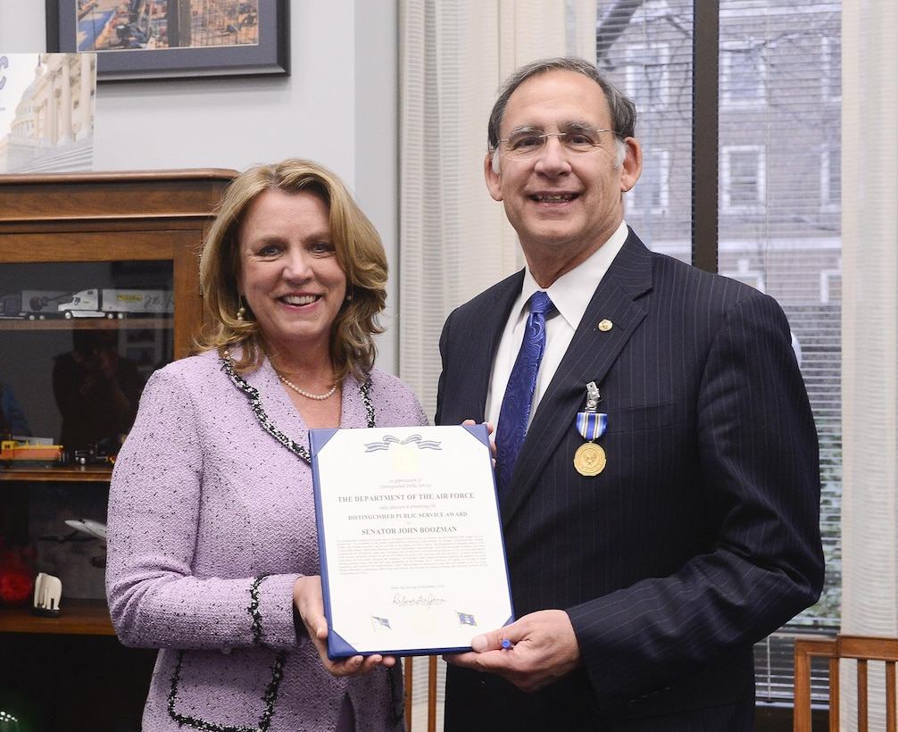 Air Force Secretary Deborah Lee James presents the Distinguished Public Service Award to U.S. Sen. John Boozman (R-AR), in Washington, D.C. Dec 6, 2016. Boozman supported the addition of a cyber training mission school at Little Rock Air Force Base, Arkansas. The first class graduation scheduled for February 2017. (U.S. Air Force photo/Andy Morataya)