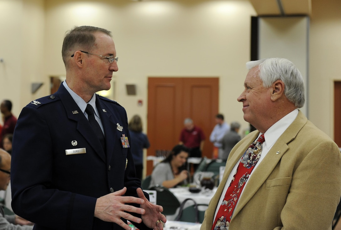 "Col. Roger Suro, 340th Flying Training Group commander, speaks with Dr. Jim Antenen, Wayland Baptist University dean, during the Chamber of Schertz-Cibolo-Selma monthly Military Affairs Committee luncheon at the Schertz Civic Center in Schertz, Texas, Dec. 6. Col. Suro was recognized as the Chamber's ""Hidden Hero"" for December. The 340 FTG, located at Joint Base San Antonio-Randolph, Texas, supports Air Education and Training Command's specialized undergraduate pilot training, joint primary pilot training, pilot instructor training, introduction to fighter fundamentals, Euro-NATO joint jet pilot training, basic military training and the Air Force Academy's Airmanship Programs. The 340th FTG is the largest flying group in the Air Force, consisting of 425 instructor pilots assigned to six squadrons. Instructors fly a variety of aircraft, including the T-1A Jayhawk, T-6A Texan II, T-38 Talon,T-41A Mescalero, T-51A, T-52A, T-53, TG-15/TG-16 gliders, and UV-18B Twin Otter. There are openings with the 340th for traditional Reserve and active Guard and Reserve instructor pilots and jumpmasters. (Air Force photo by Tech. Sgt. Ave Young, 502nd Air Base Wing Public Affairs)."
