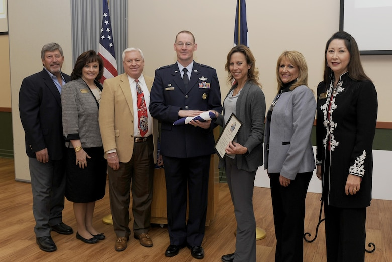 Col. Roger Suro (center), 340th Flying Training Group commander, receives a Texas state flag that was flown over the state capital building in Austin, Texas, from members of the Schertz-Cibolo-Selma Chamber during the chamber's monthly luncheon Dec. 6, at the Schertz-Civic Center in Schertz, Texas. Chamber members joining Suro in the photo are (L to R): Retired Chief Master Sgt. Tim Brown, Schertz-Cibolo-Selma Military Affairs Committee member, Kathleen Shortland, Military Affairs Committee chairman elect, Dr. Jim Antenen, Wayland Baptist University dean, Kelly Folis, Texas State Senator Donna Campbell's constituent outreach coordinator, Jill Gridley-Carpenter, Broadway Bank and Maggie Titterington, chamber president. Every month the Chamber sponsors a military member to be recognized as a Hidden Hero. The 340 FTG, located at Joint Base San Antonio-Randolph, Texas, supports Air Education and Training Command's specialized undergraduate pilot training, joint primary pilot training, pilot instructor training, introduction to fighter fundamentals, Euro-NATO joint jet pilot training, basic military training and the Air Force Academy's Airmanship Programs. The 340th FTG is the largest flying group in the Air Force, consisting of 425 instructor pilots assigned to six squadrons. Instructors fly a variety of aircraft, including the T-1A Jayhawk, T-6A Texan II, T-38 Talon, T-41A Mescalero, T-51A, T-52A, T-53, TG-15/TG-16 gliders, and UV-18B Twin Otter. There are openings with the 340th for traditional Reserve and active Guard and Reserve instructor pilots and jumpmasters. (Air Force photo by Tech. Sgt. Ave Young, 502nd Air Base Wing Public Affairs).