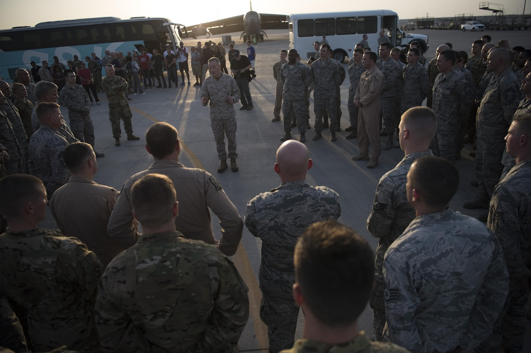 Marine Corps Gen. Joe Dunford, chairman of the Joint Chiefs of Staff, and his senior enlisted advisor, Army Command Sgt. Maj. John W. Troxell, meet with service members.