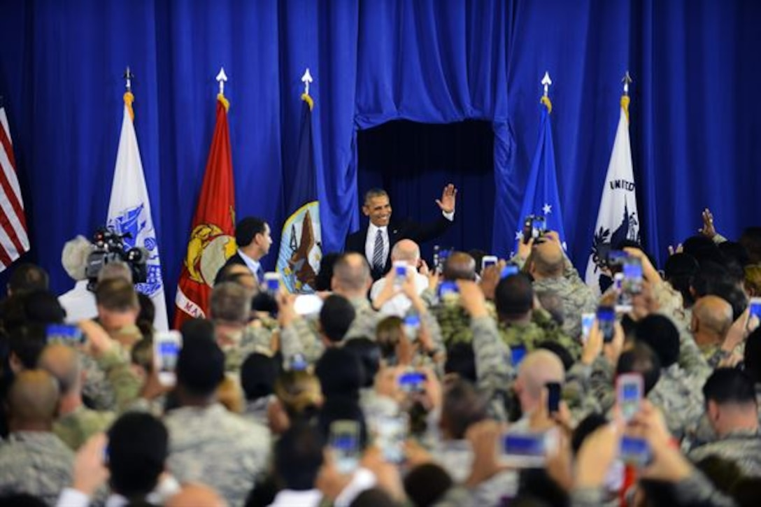 President Barack Obama greets Team MacDill as he makes his entrance prior to speaking at MacDill Air Force Base, Fla. Dec. 6, 2016. More than 2,500 personnel gathered in Hangar 1 to listen to the president's final speech on national security. (U.S. Air Force photo by Staff Sgt. Melanie Hutto)