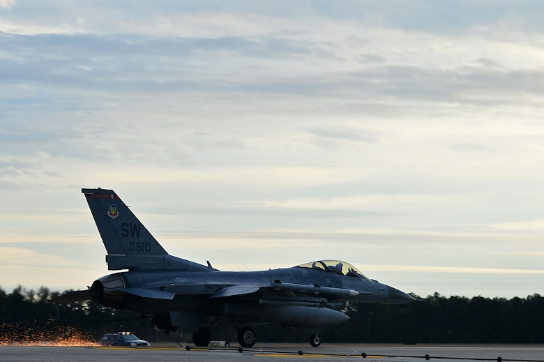 An F-16CM Fighting Falcon assigned to the 77th Fighter Squadron latches onto a Barrier Artillery Kit-12 rotary friction brake aircraft arresting system at Shaw Air Force Base, S.C., Dec. 3, 2016. The arresting systems are tested annually to ensure proper functionality when halting an aircraft in distress. (U.S. Air Force photo by Airman 1st Class Christopher Maldonado)