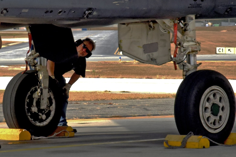 A Team Robins member inspects the F-15 flown to Robins from Seymour Johnson Air Force Base, North Carolina, by 4th Fighter Wing Commander Col. Christopher Sage. Robins is responsible for programmed depot maintenance on F-15s, proving that Success Here = Success There! (U.S. Air Force photo by Ed Aspera)