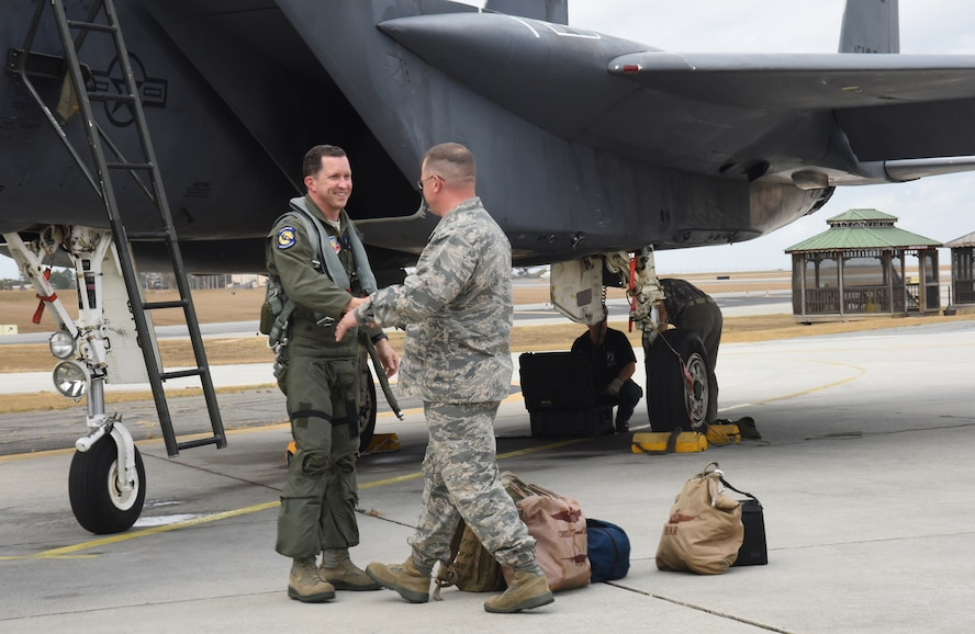 Brig. Gen. John Kubinec, Warner Robins Air Logistics Complex commander, greets Col. Christopher Sage, 4th Fighter Wing commander, following Sage's flight from Seymour Johnson Air Force Base, North Carolina. The F-15 Strike Eagle is at Robins Air Force Base for Programmed Depot Maintenance. (U.S. Air Force photo by Ed Aspera)
