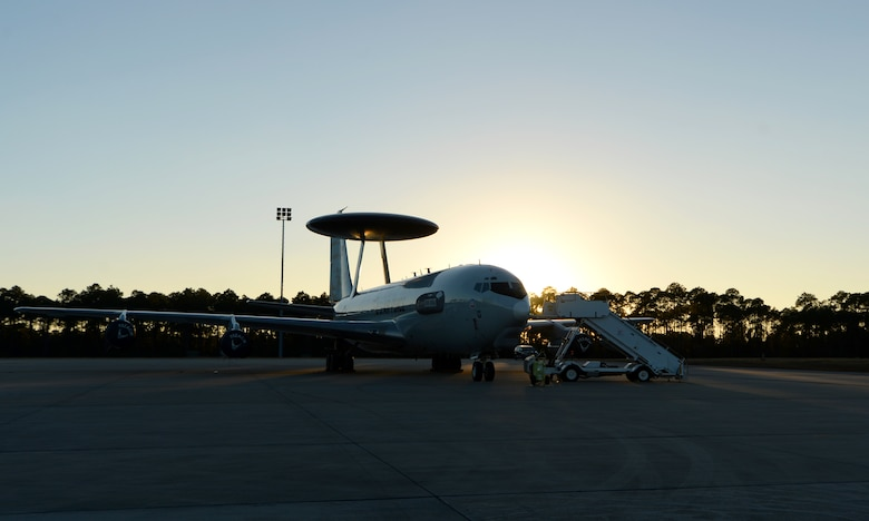 A U.S. Air Force E-3 Sentry Airborne Warning and Control System from 552nd Air Control Wing, Tinker Air Force Base, Okla., sits as the sun sets over the flightline at Tyndall Air Force Base, Fla., Dec. 6, 2016. The AWACS is at Tyndall in support of concurrent aerial exercises Checkered Flag 17-1 and Combat Archer 17-3 that runs Dec. 5-16. (U.S. Air Force photo by Airman 1st Class Isaiah J. Soliz/Released)