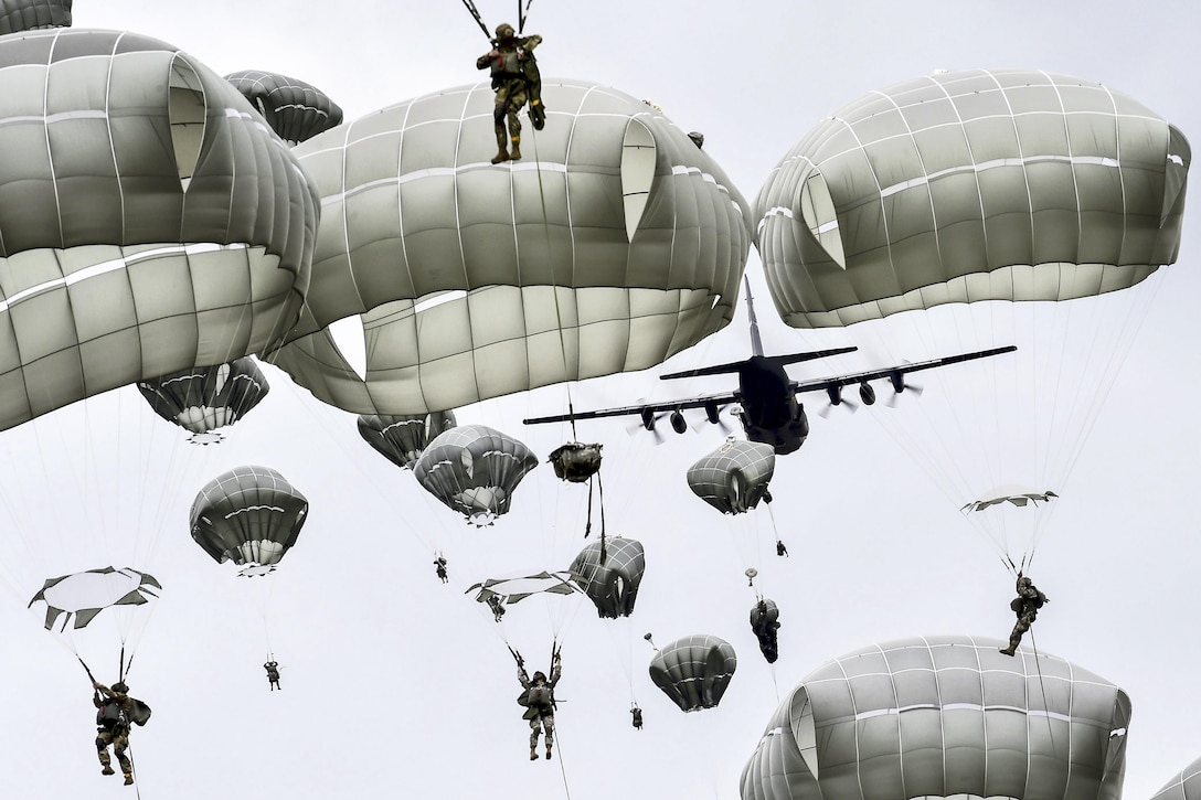 Soldiers conduct an airborne operation at Joint Base Elmendorf-Richardson, Alaska, Aug. 23, 2016, during Exercise Spartan Agoge. The soldiers are paratroopers assigned to the 25th Infantry Division's 4th Brigade Combat Team (Airborne). Air Force photo by Justin Connaher