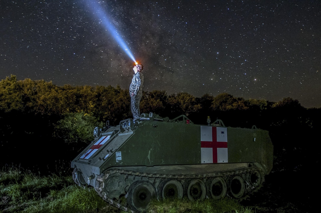 Army Pfc. Dylan Scott watches the night sky on top of an M113 medical evacuation vehicle during Exercise Saber Guardian 16 in Cincu, Romania, Aug. 3, 2016. Saber Guardian is a multinational military exercise involving about 2,800 military personnel from 10 nations: Armenia, Azerbaijan, Bulgaria, Canada, Georgia, Moldova, Poland, Romania, Ukraine and the United States. Army photo by Spc. Timothy Jackson