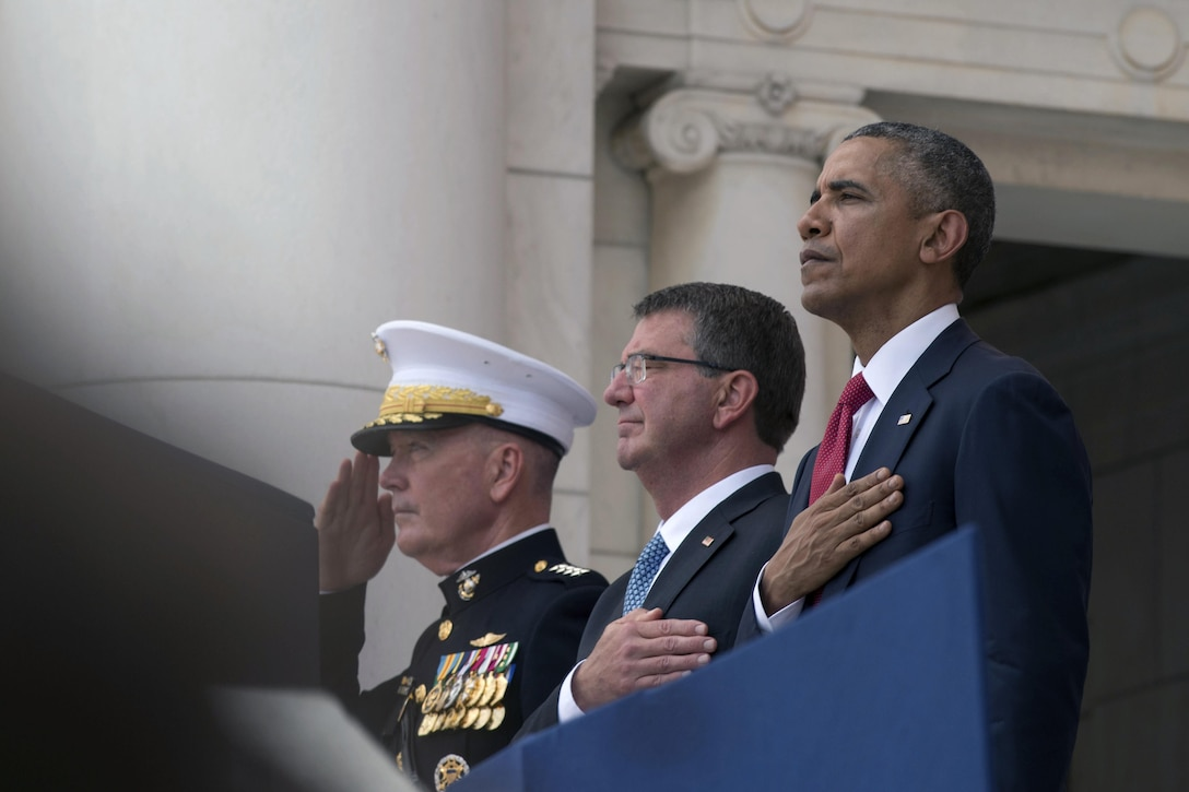 President Barack Obama, right, Defense Secretary Ash Carter and Marine Corps Gen. Joe Dunford, chairman of the Joint Chiefs of Staff, render honors during a wreath-laying ceremony to mark Memorial Day at Arlington National Cemetery in Arlington, Va., May 30, 2016. DoD photo by Air Force Senior Master Sgt. Adrian Cadiz