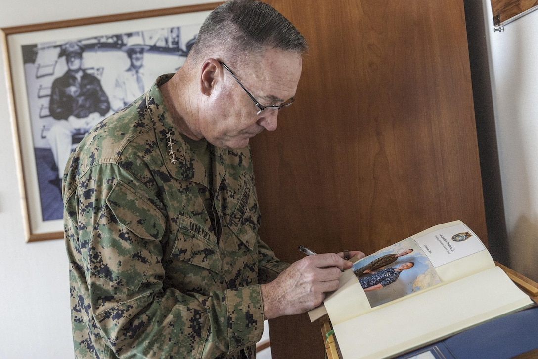 Marine Gen. Joseph F. Dunford Jr., chairman of the Joint Chiefs of Staff, signs the guestbook of Navy Adm. Harry B. Harris, commander of U.S. Pacific Command, during an office call visit at the command's headquarters on Camp H.M. Smith, Hawaii, Feb. 9, 2016. DoD Photo by Navy Petty Officer 2nd Class Dominique A. Pineiro