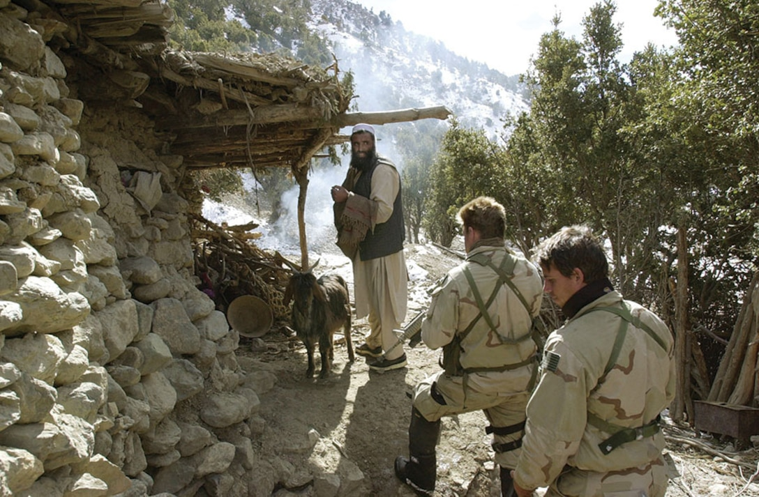 U.S. Navy Seal's search for al-Qaida and Taliban while conducting a Sensitive Site Exploitation mission in the Jaji Mountains, Jan. 12, 2002.