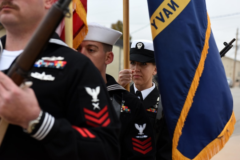 U.S. Navy sailors perform colors for the 75th Pearl Harbor remembrance ceremony at Liberty Park on Goodfellow Air Force Base, Texas, Dec. 7, 2016. The ceremony included a prayer and an audio recording by Franklin Roosevelt on the Pearl Harbor attack. (U.S. Air Force photo by Airman 1st Class Caelynn Ferguson/Released)