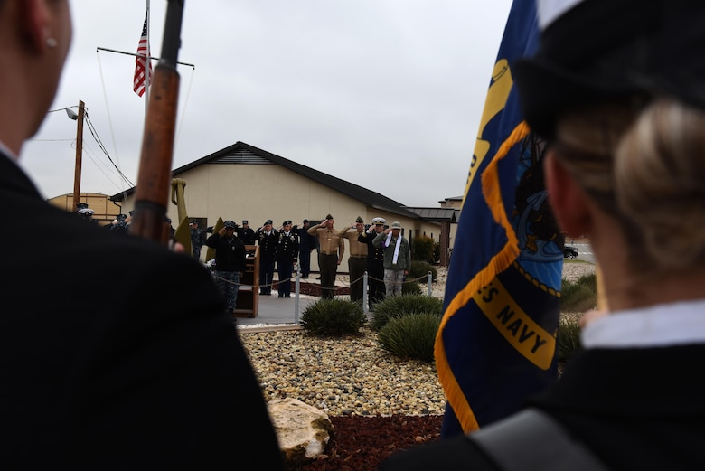 Sailors, Soldiers and Marines salute during presenting colors for the 75th Pearl Harbor remembrance ceremony at Liberty Park on Goodfellow Air Force Base, Texas, Dec. 7, 2016. Representatives from the different branches involved with Pearl Harbor came to the ceremony. (U.S. Air Force photo by Airman 1st Class Caelynn Ferguson/Released)