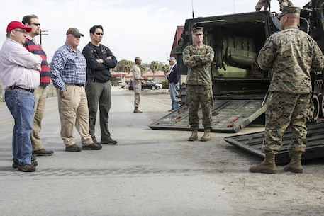 Staff Sgt. Cromwell Downs, vehicle maintenance chief, 3rd Assault Amphibian Battalion, 1st Marine Division, explains the capabilities of the assault amphibious vehicle to Defense Advanced Research Projects Agency scientists on Camp Pendleton, Calif., Dec. 5. 2016. DARPA assists the Marine Corps in improving technology and medicine to overcome challenges on future battlefields.