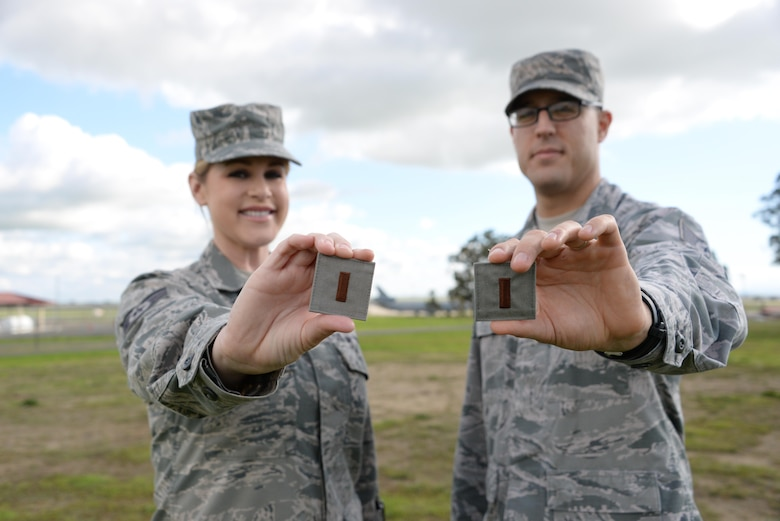Staff Sgt. Katherine Little and Tech Sgt. Maurice Morrell, both part of the 60th Air Mobility Wing Comptroller Squadron, proudly display their future second lieutenant ranks at Travis Air Force Base, Calif. Little and Morrell were each selected for Officer Training School and will commission at the end of their OTS classes in January and March, respectively. (U.S. Air Force photo by 2nd Lt. Sarah Johnson)