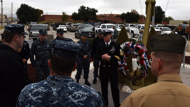 U.S. Navy Chief Petty Officer Shane Tuttle, Navy Center for Information Warfare Training Detachment Goodfellow assistant officer in charge, delivers a speech after the 75th Pearl Harbor remembrance ceremony at Liberty Park on Goodfellow Air Force Base, Texas, Dec. 7, 2016. He asked sailors in training what they knew about the Pearl Harbor attack and spoke of how it relates to their training today. (U.S. Air Force photo by Airman 1st Class Caelynn Ferguson/Released)