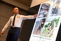 Chief Master Sgt. Manny Pineiro, Air Force District of Washington First Sergeant, briefs the Air Force's impact on the joint mission during the National Capital Region Joint Professional Development Seminar in Washington D.C. on Nov. 30, 2016. The seminar was held at the National Defense University on Ft. McNair and helps NCOs develop skills to prepare them for challenges they may face filling joint mission requirements. (U.S. Air Force photo/Tech. Sgt. Matt Davis)
