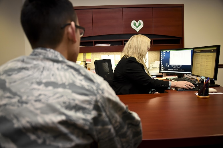 Dr. Debra Wales, 707th Force Support Squadron Education Services officer and flight chief, provides a tuition assistance briefing to an Airman, Dec. 2, 2016 at Fort Meade, Md. The 707th FSS Education and Training Office is a one-stop shop for assistance with Community College of the Air Force degree programs, CLEP and DANTES test, CDC and PME exams, language testing, formal training and also providing education counseling and briefings. (U.S. Air Force photo/Staff Sgt. AJ Hyatt)
