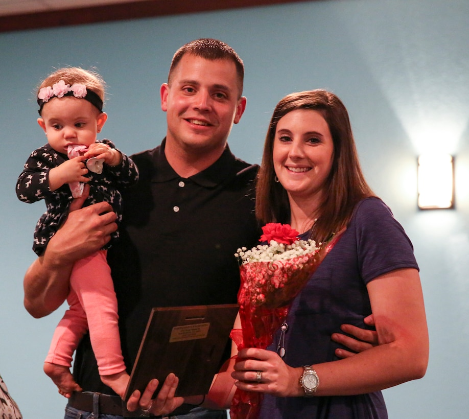 Sgt. Robert Newborg and his family pose for a photo after receiving the Military Family of the Quarter award in Havelock, N.C., Oct. 25, 2016. The award is given to the military family that has most positively impacted the local community over the past quarter. The Newborg's donated and volunteered time and energy to the community by working with organizations such as the Knights of Columbus and a local elementary school. Newborg is a cryptologic equipment instructor at the Center of Naval Aviation Technical Training aboard Marine Corps Air Station Cherry Point, N.C. (U.S. Marine Corps photo by Lance Cpl. Cody Lemons/Released)
